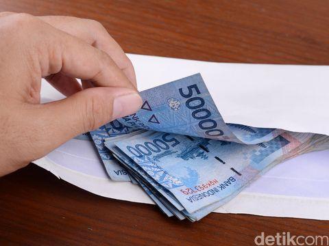 Ilustrasi uang gaji.