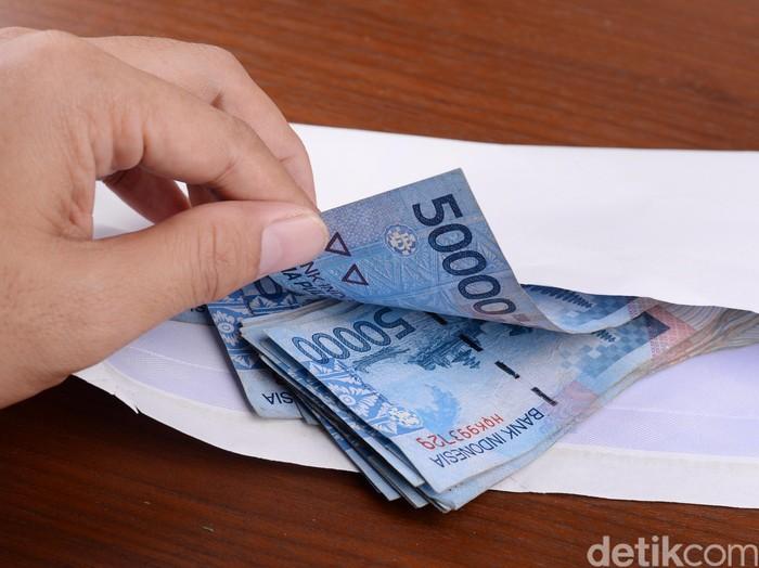 ilustrasi uang (Foto: Ari Saputra)