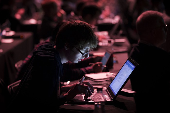 An attendee works at his laptop during the TechCrunch Disrupt 2015 conference in London, U.K., on Monday, Dec. 7, 2015. TechCrunch Disrupt gathers the best and brightest entrepreneurs, investors, and hackers to discuss whats top of mind for the tech industrys key innovators. Photographer: Jason Alden/Bloomberg via Getty Images