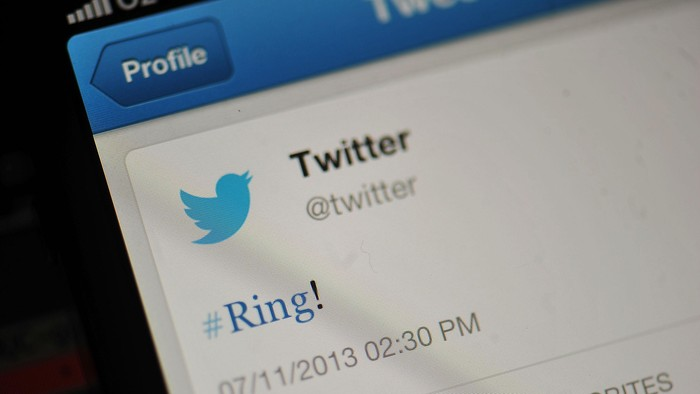 LONDON, ENGLAND - NOVEMBER 07:  In this photo illustration, the Twitter logo and hashtag #Ring! is displayed on a mobile device as the company announced its initial public offering and debut on the New York Stock Exchange on November 7, 2013 in London, England. Twitter went public on the NYSE opening at USD 26 per share, valuing the companys worth at an estimated USD 18 billion.  (Photo by Bethany Clarke/Getty Images)