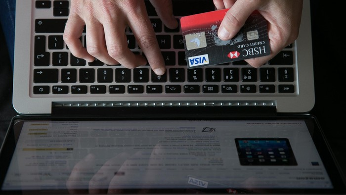 BRISTOL, UNITED KINGDOM - AUGUST 11:  In this photo illustration a woman uses a credit card to buy something online on August 11, 2014 in Bristol, United Kingdom. This week marks the 20th anniversary of the first online sale. Since that sale - a copy of an album by the artist Sting - online retailing has grown to such an extent that it is now claimed that 95 percent of the UK population has shopped online and close to one in four deciding to shop online each week.  (Photo Illustration by Matt Cardy/Getty Images)
