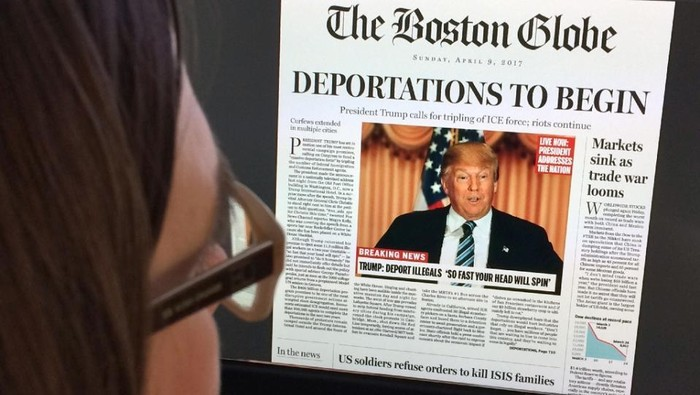A woman on April 10, 2016 reads online a mockup by The Boston Globe of what a frontpage might look like should Donald Trump win the US presidency (AFP Photo/Karen Bleier)