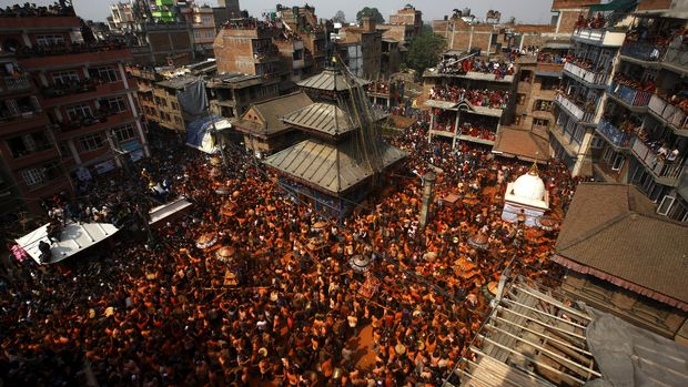 Devotees carry a chariot as they celebrate the