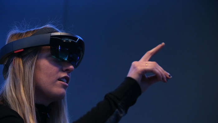 SAN FRANCISCO, CA - MARCH 30:  Microsoft employee Gillian Pennington demonstrates the Microsoft HoloLens augmented reality (AR) viewer during the 2016 Microsoft Build Developer Conference on March 30, 2016 in San Francisco, California. The Microsoft Build Developer Conference runs through April 1.  (Photo by Justin Sullivan/Getty Images)