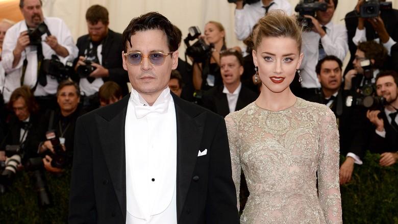 Johnny Depp dan Amber Heard (Foto: Dimitrios Kambouris/Getty Images)