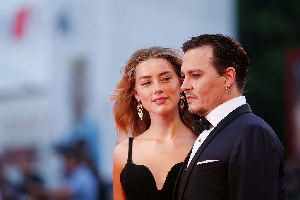 VENICE, ITALY - SEPTEMBER 04:  Johnny Depp and Amber Heard attend a premiere for 'Black Mass' during the 72nd Venice Film Festival at  on September 4, 2015 in Venice, Italy.  (Photo by Tristan Fewings/Getty Images)