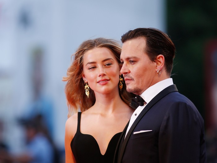 VENICE, ITALY - SEPTEMBER 04:  Johnny Depp and Amber Heard attend a premiere for Black Mass during the 72nd Venice Film Festival at  on September 4, 2015 in Venice, Italy.  (Photo by Tristan Fewings/Getty Images)