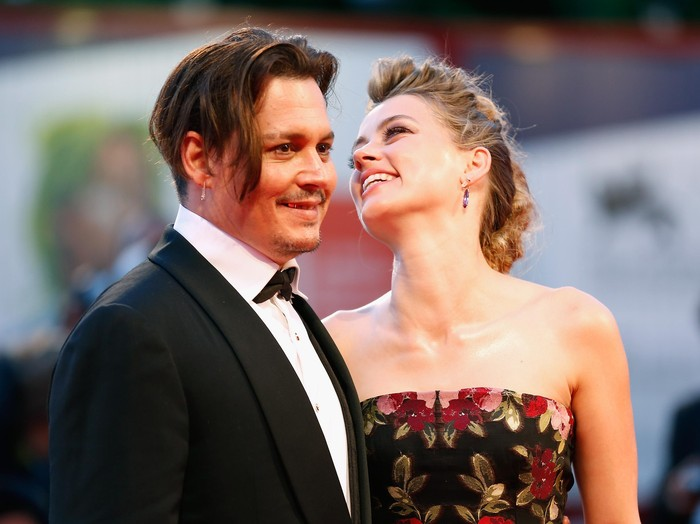VENICE, ITALY - SEPTEMBER 05:  Johnny Depp and actress Amber Heard attend a premiere for The Danish Girl during the 72nd Venice Film Festival at  on September 5, 2015 in Venice, Italy.  (Photo by Tristan Fewings/Getty Images)