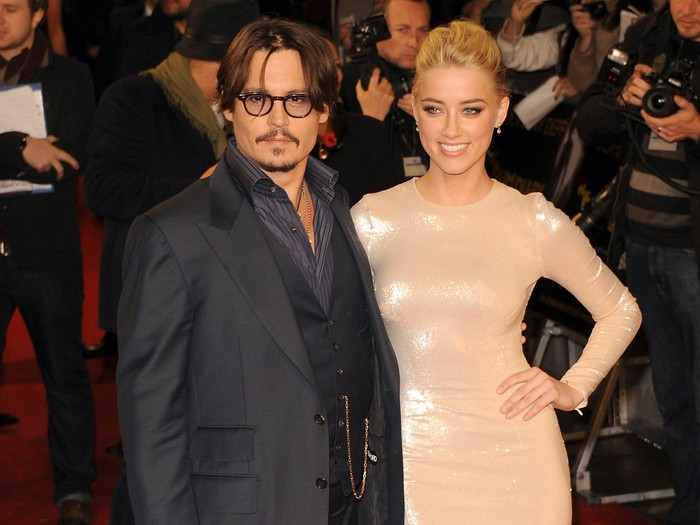 LONDON, UNITED KINGDOM - NOVEMBER 03: Johnny Depp and Amber Heard attend The UK Premiere of The Rum Diary at  on November 3, 2011 in London, England. (Photo by Stuart Wilson/Getty Images)