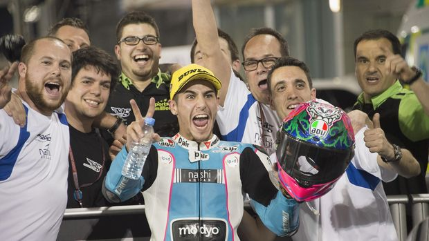 DOHA, QATAR - MARCH 20: Luis Salom of Spain and SAG Team celebrates with team under the podium at the end of the Moto2 race during the MotoGp of Qatar - Race at Losail Circuit on March 20, 2016 in Doha, Qatar. (Photo by Mirco Lazzari gp/Getty Images)