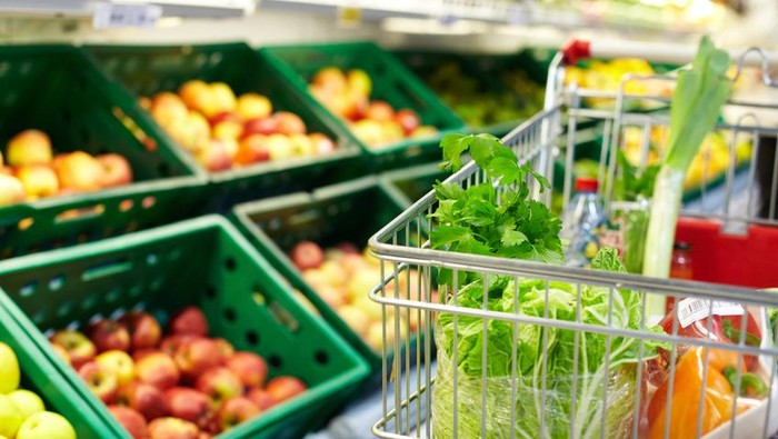 Image of fresh vegetables in cart in supermarket