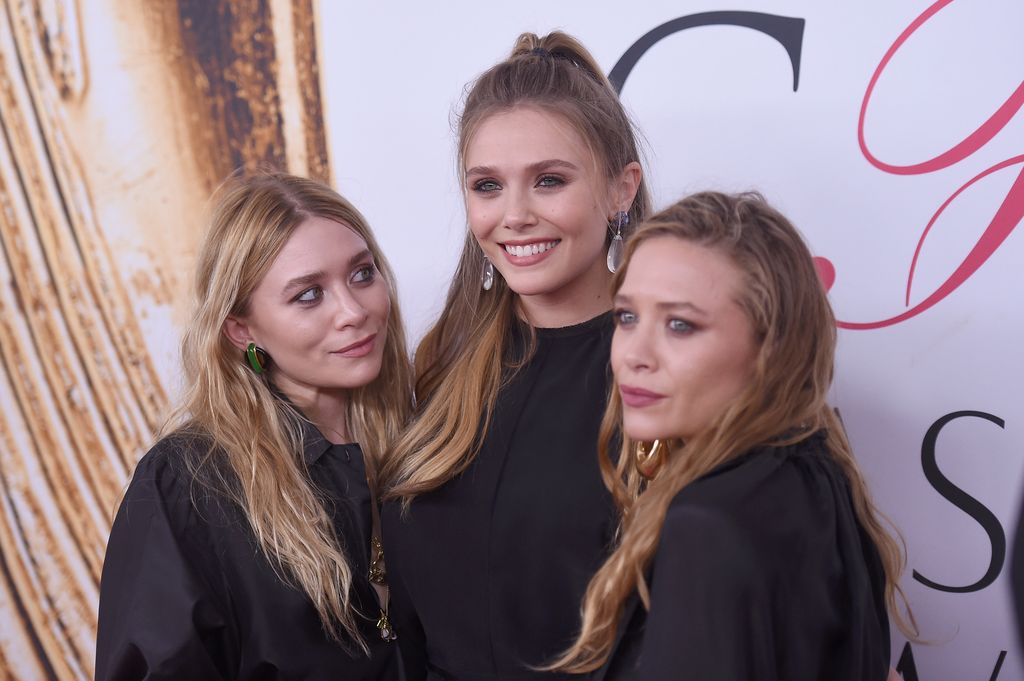 NEW YORK, NY - JUNE 06:  Elizabeth Olsen (center) and Mary-Kate and Ashley Olsen attend the 2016 CFDA Fashion Awards at the Hammerstein Ballroom on June 6, 2016 in New York City.  (Photo by Jamie McCarthy/Getty Images)