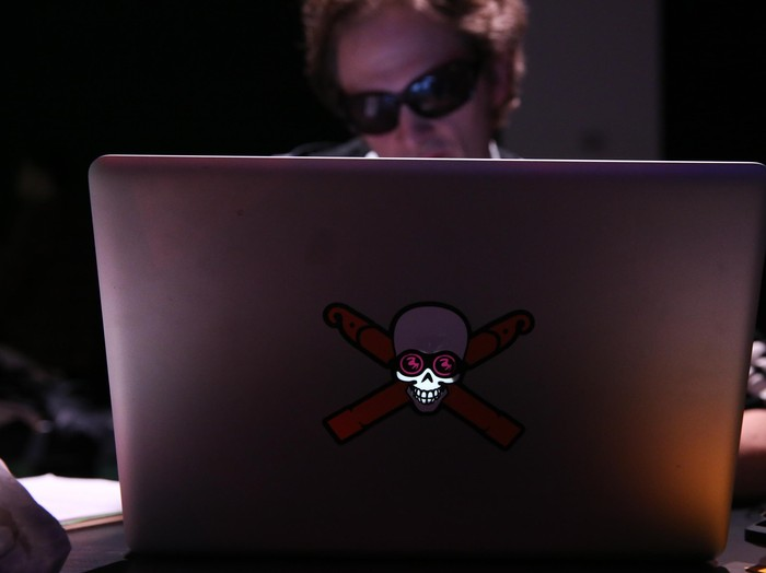 NEW YORK, NY - APRIL 15:  A hacker using a laptop computer at the Hacked By Def Con Press Preview during the 2016 Tribeca Film Festival at Spring Studios on April 15, 2016 in New York City.  (Photo by Rob Kim/Getty Images for Tribeca Film Festival)