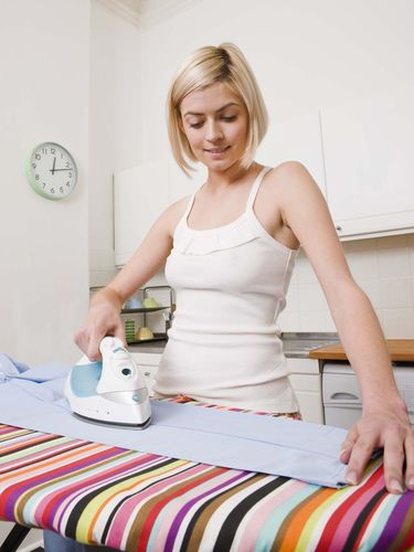 Woman ironing laundry