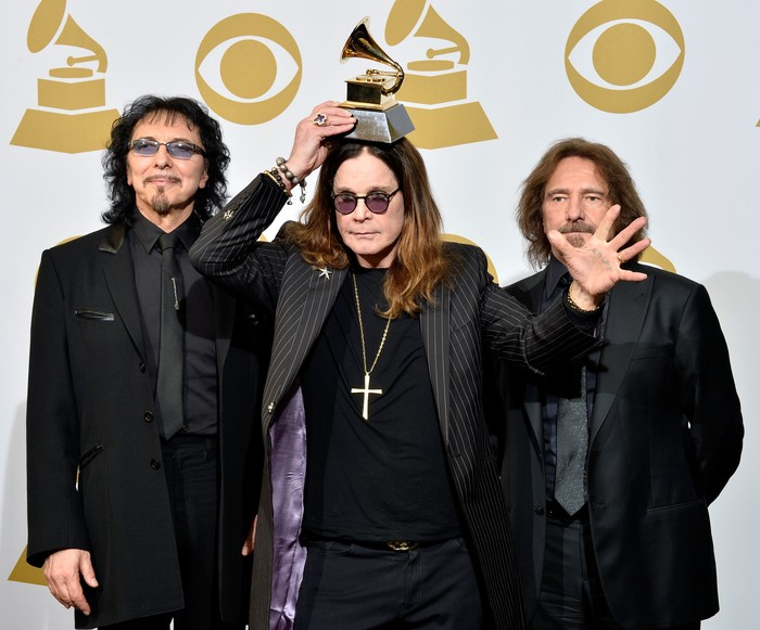 LOS ANGELES, CA - JANUARY 26:  (L-R) Recording artists Tony Iommi, Ozzy Osbourne and Geezer Butler of Black Sabbath pose in the press room during the 56th GRAMMY Awards at Staples Center on January 26, 2014 in Los Angeles, California.  (Photo by Frazer Harrison/Getty Images)