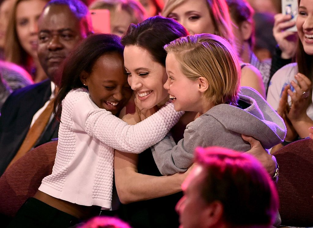 INGLEWOOD, CA - MARCH 28:  Actress Angelina Jolie hugs Zahara Marley Jolie-Pitt (L) and Shiloh Nouvel Jolie-Pitt (R) after winning award for Favorite Villain in 'Maleficent' during Nickelodeon's 28th Annual Kids' Choice Awards held at The Forum on March 28, 2015 in Inglewood, California.  (Photo by Kevin Winter/Getty Images)