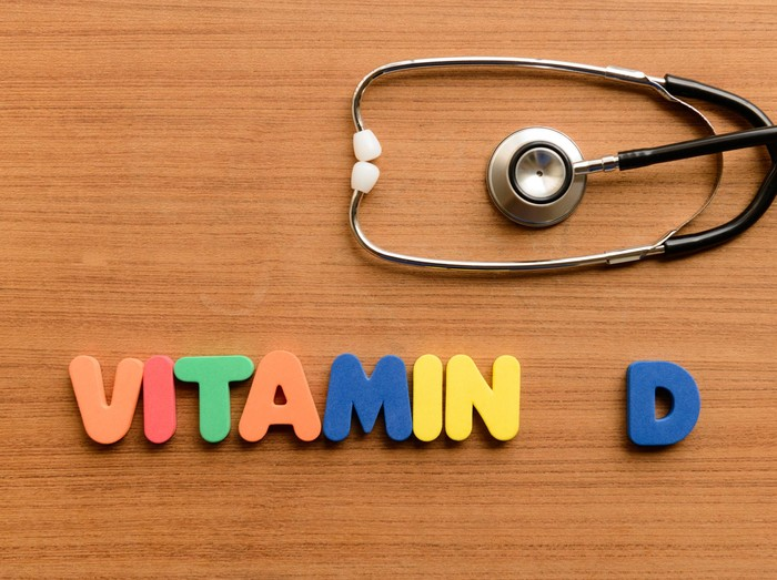 Vitamin D  colorful word on the wooden background