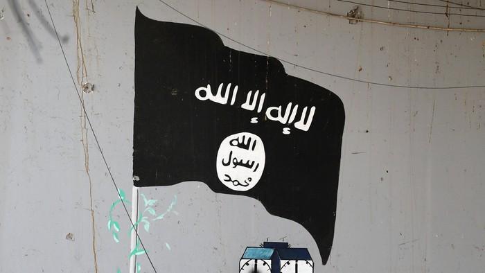Bendera dan logo ISIS. REUTERS