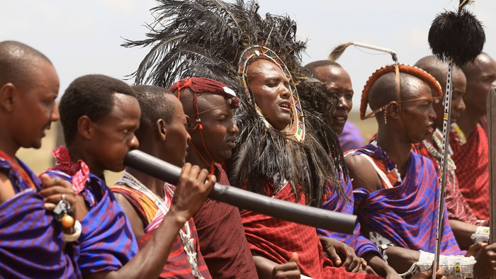 ARUSHA, TANZANIA - NOVEMBER 09:  Maasai men prepare to greet Camilla, Duchess of Cornwall and Prince Charles, Prince of Walesas they visit  Majengo Maasai Boma on November 9, 2011 in Arusha, Tanzania. The Prince of Wales and the Duchess of Cornwall are on the final day of a four day tour of Tanzania after a successful trip to South Africa. The Royal couple will be highlighting environmental and social issues during their visit to Africa.  (Photo by Chris Jackson/Getty Images)