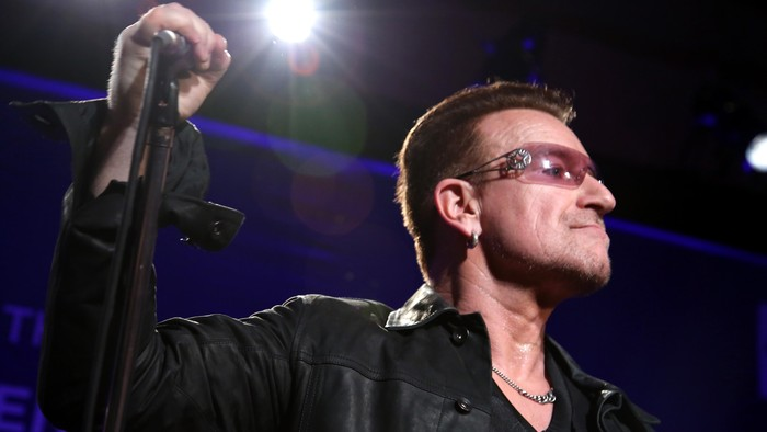 BEVERLY HILLS, CA - JANUARY 11: Bono of U2 performs onstage during the 3rd annual Sean Penn & Friends HELP HAITI HOME Gala benefiting J/P HRO presented by Giorgio Armani at Montage Beverly Hills on January 11, 2014 in Beverly Hills, California.  (Photo by Jonathan Leibson/Getty Images for J/P Haitian Relief Organization)
