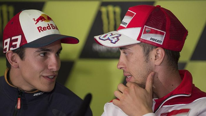 PARIS, FRANCE - MAY 14:   Andrea Dovizioso of Italy and Ducati Team speaks with Marc Marquez of Spain and Repsol Honda Team (L) during the MotoGp of France - Press Conference at  on May 14, 2015 in Paris, France.  (Photo by Mirco Lazzari gp/Getty Images)
