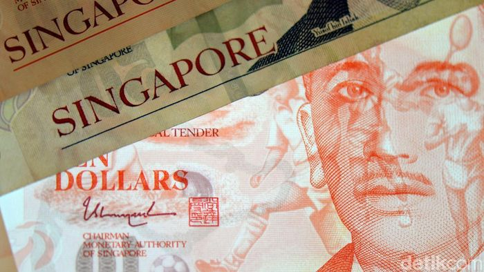 Dolar Singapura. Foto: Ari Saputra
