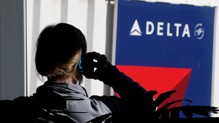 FILE PHOTO - A passenger talks on her phone at a Delta Airlines gate a day before the annual Thanksgiving Day holiday at the Salt Lake City international airport, in Salt Lake City, Utah November 21, 2012.    REUTERS/George Frey/File Photo