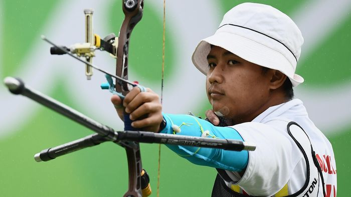 RIO DE JANEIRO, BRAZIL - AUGUST 12: Riau Ega Agatha of Indonesia competes in the Mens Individual round of 8 Elimination Round on Day 7 of the Rio 2016 Olympic Games at the Sambodromo on August 12, 2016 in Rio de Janeiro, Brazil.  (Photo by Matthias Hangst/Getty Images)