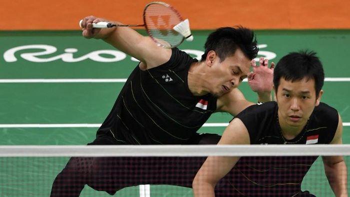 Hendra Setiawan/Mohammad Ahsan akan tampil di Malaysia Terbuka 2019. (Ed Jones / AFP)