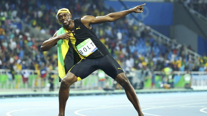 2016 Rio Olympics - Athletics - Final - Mens 100m Final - Olympic Stadium - Rio de Janeiro, Brazil - 14/08/2016. Usain Bolt (JAM) of Jamaica poses after winning the gold.  REUTERS/Lucy Nicholson TPX IMAGES OF THE DAY. FOR EDITORIAL USE ONLY. NOT FOR SALE FOR MARKETING OR ADVERTISING CAMPAIGNS.