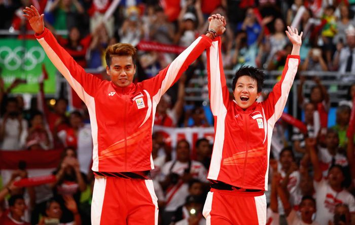 RIO DE JANEIRO, BRAZIL - AUGUST 17: Gold medalists, Tontowi Ahmad and Liliyana Natsir of Indonesia celebrate winning the Mixed Doubles Gold Medal Match against Peng Soon Chan and Liu Ying Goh of Malaysia on Day 12 of the Rio 2016 Olympic Games at Riocentro - Pavilion 4 on August 17, 2016 in Rio de Janeiro, Brazil. (Photo by Dean Mouhtaropoulos/Getty Images)