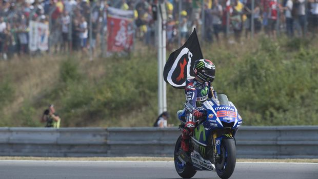 BRNO, CZECH REPUBLIC - AUGUST 16:  Jorge Lorenzo of Spain and Movistar Yamaha MotoGP celebrates the victory with flag at the end of the MotoGP race during the MotoGp of Czech Republic - Race at Brno Circuit on August 16, 2015 in Brno, Czech Republic.  (Photo by Mirco Lazzari gp/Getty Images)