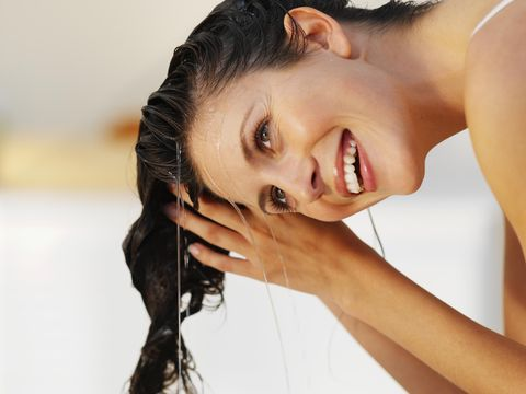 Close-up of a woman rinsing her hair