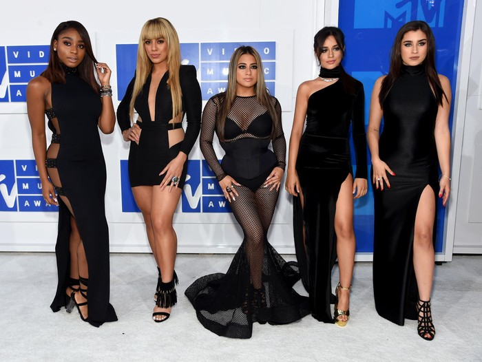LOS ANGELES, CA - NOVEMBER 20:  Recording artists Lauren Jauregui, Dinah Jane Hansen, Normani Hamilton, Ally Brooke and Camila Cabello of Fifth Harmony and Ty Dolla Sign accept Collaboration of the Year for Work from Home onstage during the 2016 American Music Awards at Microsoft Theater on November 20, 2016 in Los Angeles, California.  (Photo by Kevin Winter/Getty Images)