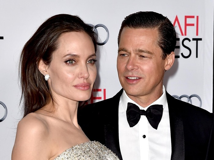 LOS ANGELES, CA - NOVEMBER 05:  Actress/director Angelina Jolie Pitt (L) and husband actor Brad Pitt arrive at the AFI FEST 2015 presented by Audi opening night gala premiere of Universal Pictures
