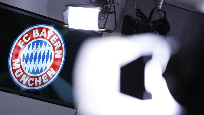 MUNICH, GERMANY - MARCH 14: A club logo is seen behind TV lights during a press conference at the offices of German football club FC Bayern following the announcement by Uli Hoeness that he has resigned as club governing board chairman and will not appeal the three and half year jail sentence handed down by a Munich court the day before on March 14, 2014 in Munich, Germany. A judge found Hoeness guilty of evading taxes totaling at least EUR 27.2 million and declared his pre-emptive attempt at turning himself in to German tax authorities as invalid. Hoeness has been a pillar in German football club history, beginning with his career as a stellar professional player with FC Bayern in the 1970s to his role as FC Bayern club chairman, during which the Bundesliga team has been among the most successful in Germany.  (Photo by Philipp Guelland/Getty Images)
