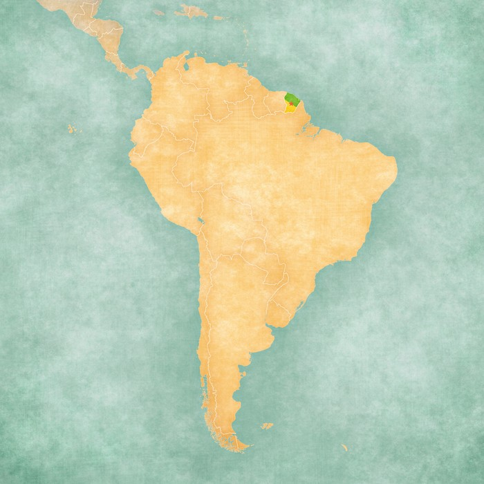 French Guiana (Flag of the department) on the map of South America. The Map is in vintage summer style and sunny mood. The map has a soft grunge and vintage atmosphere, which acts as a watercolor painting.