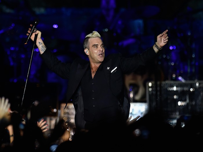 MONACO - JULY 12:  Robbie Williams performs onstage during the Second Day of the 10th Anniversary on the Throne Celebrations on July 12, 2015 in Monaco, Monaco.  (Photo by Pascal Le Segretain/Getty Images)