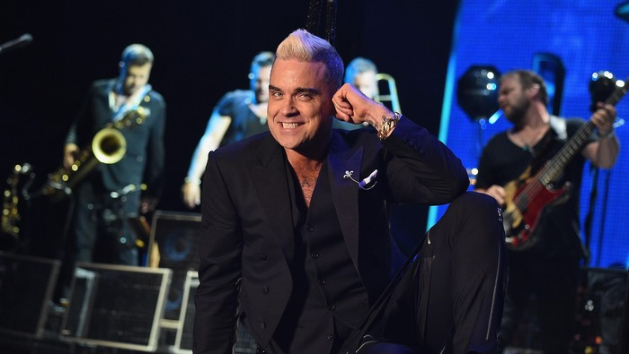 MONACO - JULY 12:  Robbie Williams performs onstage the Second Day of the 10th Anniversary on the Throne Celebrations on July 12, 2015 in Monaco, Monaco.  (Photo by PLS Pool/Getty Images)