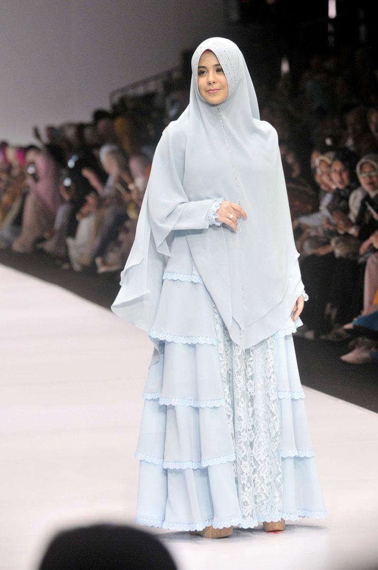Ia terlihat cantik dengan busana muslim rancangan Si.Se.Sa. Pool/Noel/detikFoto.