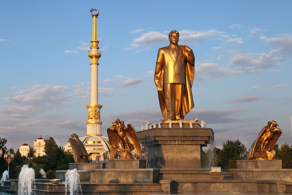 Monumen of Niyazov and Arch of Independence in sunset. Ashkhabad. Turkmenistan.