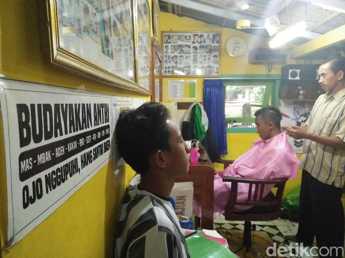 Ilustrasi tukang cukur (Foto: Kartika S Tarigan/detikcom)