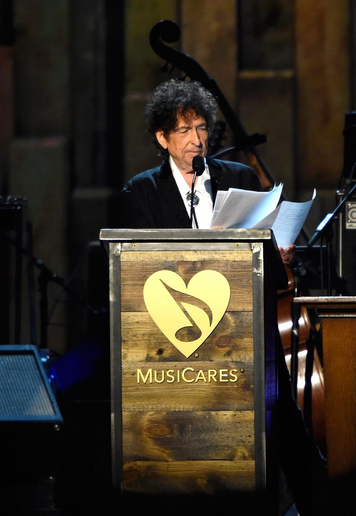 LOS ANGELES, CA - FEBRUARY 06:  Honoree Bob Dylan speaks onstage at the 25th anniversary MusiCares 2015 Person Of The Year Gala honoring Bob Dylan at the Los Angeles Convention Center on February 6, 2015 in Los Angeles, California. The annual benefit raises critical funds for MusiCares Emergency Financial Assistance and Addiction Recovery programs.  (Photo by Frazer Harrison/Getty Images)