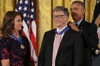 WASHINGTON, DC - NOVEMBER 22:  U.S. President Barack Obama (R) awards the Presidential Medal of Freedom to Microsoft founder Bill Gates (C) and his wife Melinda Gates (L), who have donated billions of dollars globally to promote health and fight poverty, during a ceremony in the East Room of the White House November 22, 2016 in Washington, DC. Obama presented the medal to 19 living and two posthumous pioneers in science, sports, public service, human rights, politics and the arts.  (Photo by Chip Somodevilla/Getty Images)