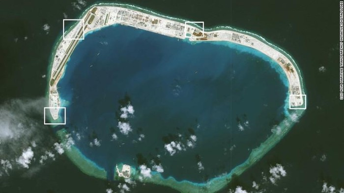 A satellite image of Mischief Reef taken on November 15. AMTI says two of the four structures have been completed, with covers already placed over the systems installed there. (CSIS Asia Maritime Transparency Initiative/Digital Globe)