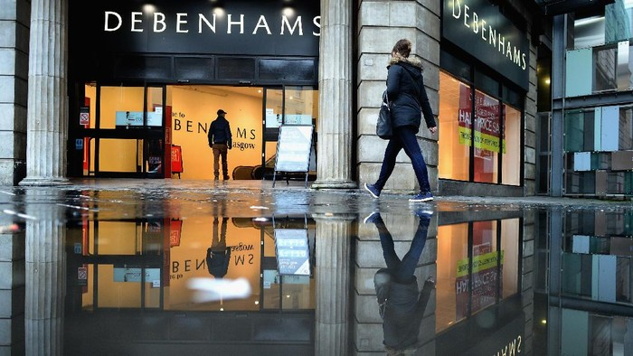 GLASGOW, UNITED KINGDOM - JANUARY 02:  Members of the public walk past Debenhams store as companies announce Christmas sales results  on January 2, 2014 in Glasgow, United Kingdom.Shares in the department store Debenhams have fallen following the company announcing poor sales during the Christmas period.  (Photo by Jeff J Mitchell/Getty Images)