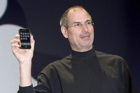SAN FRANCISCO, CA - JANUARY 9: Apple CEO Steve Jobs holds up the new iPhone that was introduced at Macworld on January 9, 2007 in San Francisco, California. During the keynote Jobs introduced the new iPhone which will combine a mobile phone, a widescreen iPod with touch controls and a internet communications device with the ability to use email, web browsing, maps and searching. The iPhone will start shipping in the US in June 2007. (Photo by David Paul Morris/Getty Images)