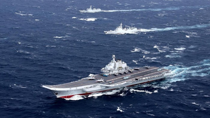 FILE PHOTO: Chinas Liaoning aircraft carrier with accompanying fleet conducts a drill in an area of South China Sea, in this undated photo taken December, 2016. REUTERS/Stringer/File photo ATTENTION EDITORS - THIS IMAGE WAS PROVIDED BY A THIRD PARTY. EDITORIAL USE ONLY. CHINA OUT     TPX IMAGES OF THE DAY