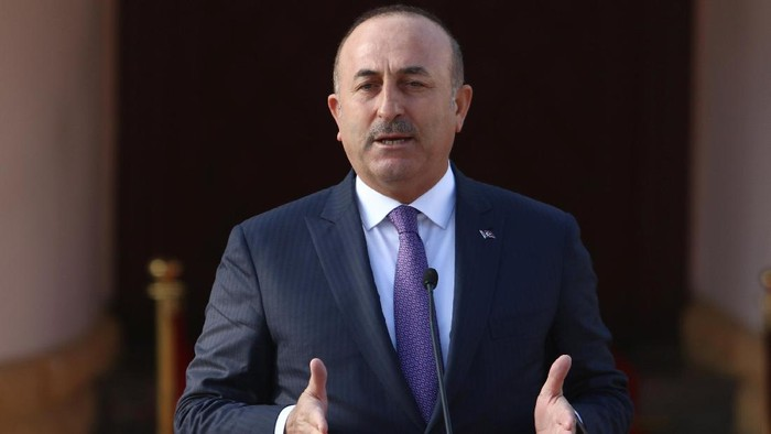 Turkeys Foreign Minister Mevlut Cavusoglu speaks to the media during a visit in Nicosia, northern Cyprus, February 21, 2017. REUTERS/Yiannis Kourtoglou