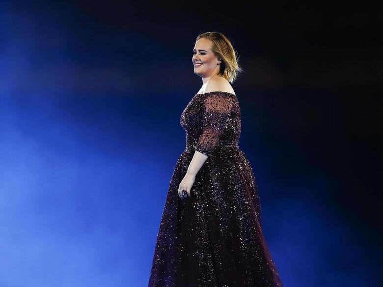 Takut Cuaca Pengaruhi Suaranya, Adele Tunda Konser
